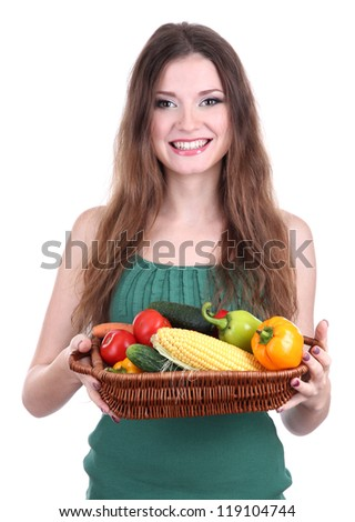 Beautiful woman with vegetables in wicker basket isolated on white