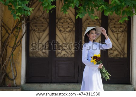Beautiful woman with Vietnam culture traditional dress,Ao dai is