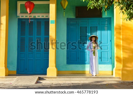 Beautiful  woman with Vietnam culture traditional dress,Ao dai is famous traditional costume ,vintage style,Hoi an Vietnam