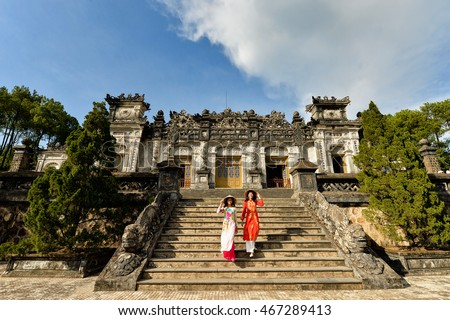 Beautiful  woman with Vietnam culture traditional dress,Ao dai is famous traditional costume ,vintage style,Grand stairs in Imperial Khai Dinh Tomb in Hue ,Vietnam