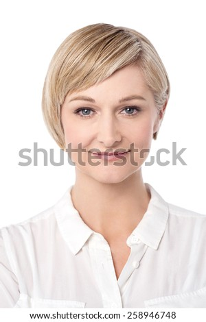 Beautiful woman with warm smile, looking at camera. - stock photo