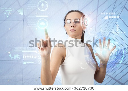 Beautiful woman with white dress with digital touchscreen - stock photo
