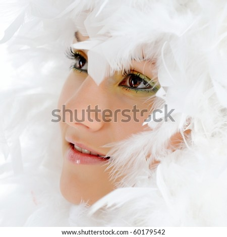 beautiful woman with white feathers