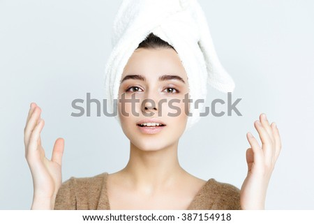 beautiful woman with white towel on his head. Spa Woman. Beautiful Girl After Bath. Perfect Skin. Skincare. Young Skin  - stock photo