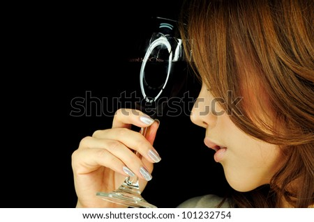 Beautiful woman with wine glass in hand - stock photo