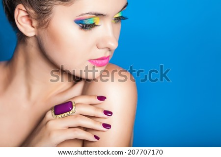 Beautiful woman with yellow and blue makeup. Professional make up.