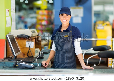 beautiful woman working as a cashier at the supermarket - stock photo