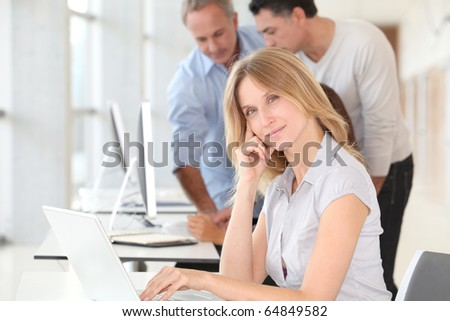 Beautiful woman working in the office on laptop computer