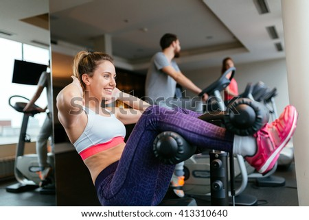 Beautiful woman working on abs muscles