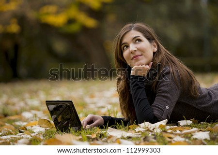 Beautiful woman working with a laptop in outdoor