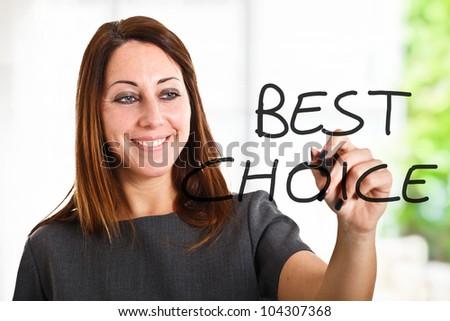 Beautiful woman writing Best - stock photo