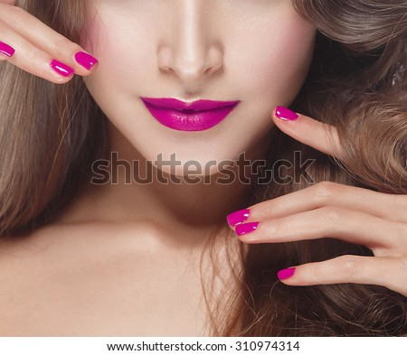Beautiful woman young face with pink lips and pink manicure  - stock photo