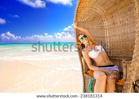 Beautiful woman young lady with sunglasses relaxing on the tropical beach enjoying sea view natural sunlight. Freedom travel vacation outdoors lifestyle leisure wellness concept  - stock photo
