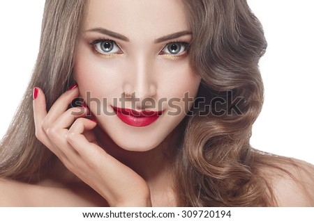 Beautiful woman young model with red lips and red manicure isolated on white