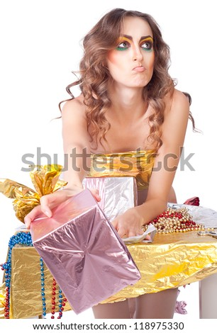beautiful womanl with bright make-up giving gift box with emotions - stock photo