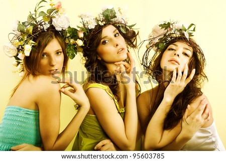 Beautiful womans with flower wreath. - stock photo