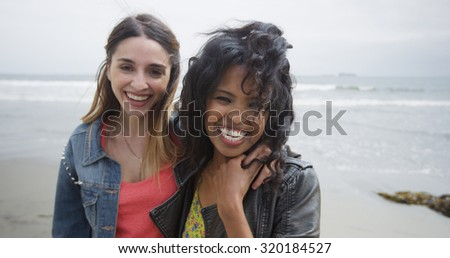 Beautiful women at the beach smiling at camera