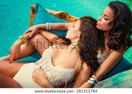 beautiful women  by the pool enjoy in sunbath summer  day - stock photo