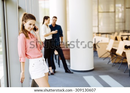 Beautiful women, colleagues using phones and talking during break