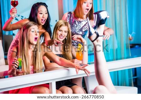Beautiful women dancing in discotheque having fun - stock photo