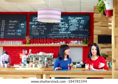 beautiful women discussing business in relaxed atmosphere - stock photo