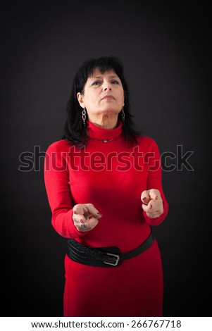 Beautiful women doing different expressions in different sets of clothes: gun sign
