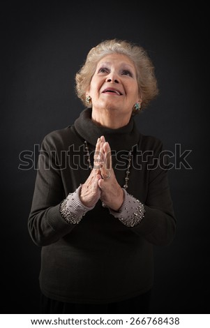 Beautiful women doing different expressions in different sets of clothes: prayer - stock photo