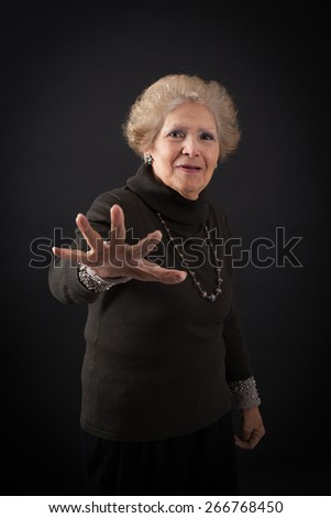 Beautiful women doing different expressions in different sets of clothes: stop sign - stock photo
