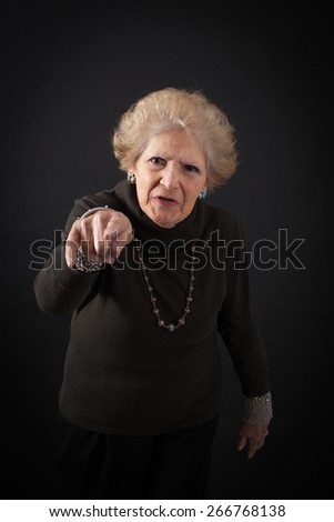 Beautiful women doing different expressions in different sets of clothes: suspicion - stock photo