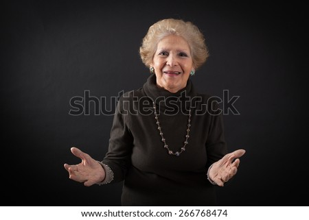 Beautiful women doing different expressions in different sets of clothes: welcome - stock photo