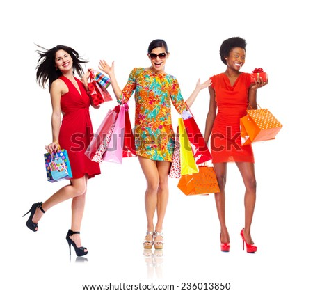 Beautiful women group with shopping bags isolated white background - stock photo