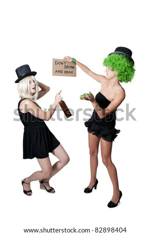 Beautiful Women Holding a Dont Drink and Drive Sign - stock photo