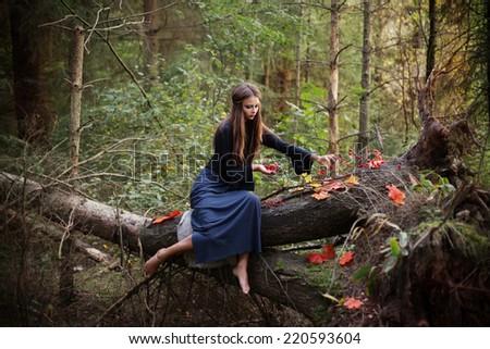beautiful women in autumn forest - stock photo