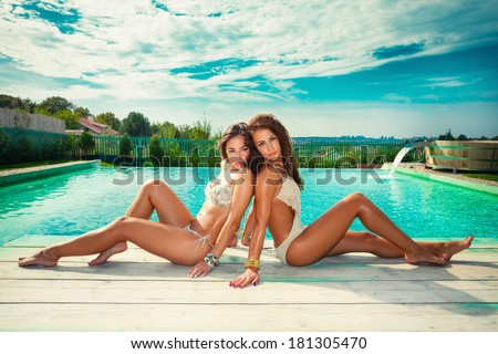 beautiful women in  bikini  by the pool summer hot day - stock photo