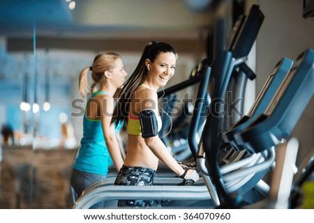 Beautiful women in gym - stock photo