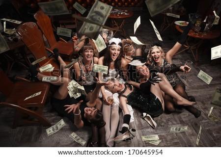 Beautiful women  in the rain of money - stock photo
