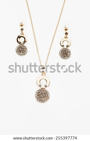 beautiful women jewelry set necklace and earrings on white