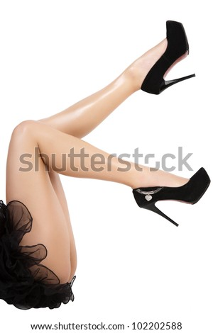 Beautiful women legs in black shoes on white background. - stock photo