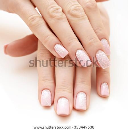 Beautiful women manicure isolated on white background - stock photo