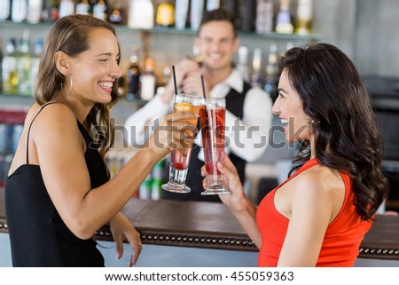 Beautiful women toasting cocktail glasses