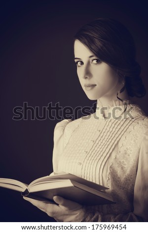 Beautiful women with book. Photo in old color image style. - stock photo