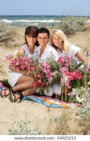 beautiful women with flowers - stock photo