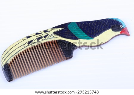 Beautiful wood comb isolated on white background