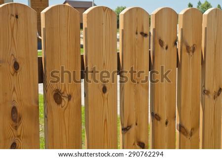 Beautiful wood garden fence.Closeup. - stock photo