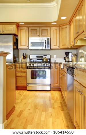 Beautiful wood kitchen with stainless steal appliances. - stock photo