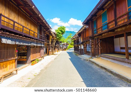 Beautiful wood structures line the sides of the main street of Tsumago on the Tsumago-Magome portion of Nakasendo route in Gifu, Japan. Horizontal