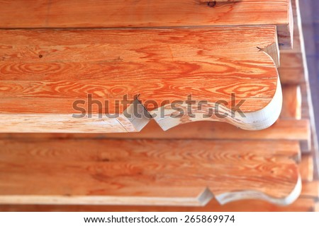 Beautiful wood texture visible on carved beams of traditional roof, Cortina d'Ampezzo, Dolomite Alps, Italy - stock photo