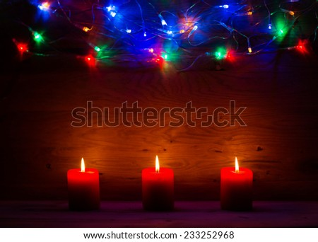 beautiful wooden background for labels with Christmas lights and candles - stock photo