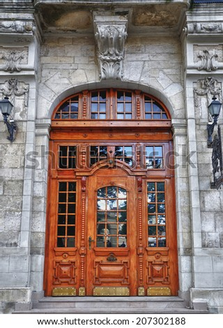 Beautiful wooden door with glass inserts .. - stock photo