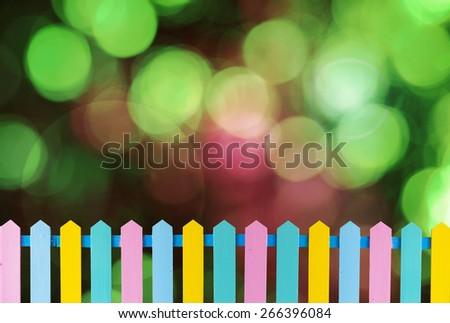 Beautiful wooden fence on bokeh background. - stock photo